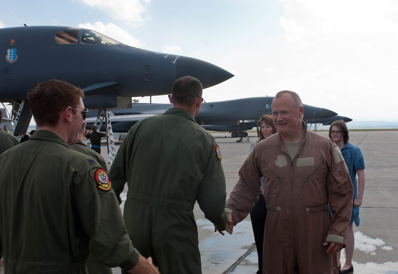 Airmen congratulate Lt. Col. Timothy Schepper, 28th Operations Group senior evaluator, on being the first person to achieve 5,000 hours flying B-1 bombers at Ellsworth Air Force Base, S.D., July 15, 2013. Schepper's accomplishment is one of the many milestones for the B-1, which includes eight years of consecutive deployment and racking up nearly 10,000 combat missions. (U.S. Air Force photo by Airman 1st Class Zachary Hada/Released)