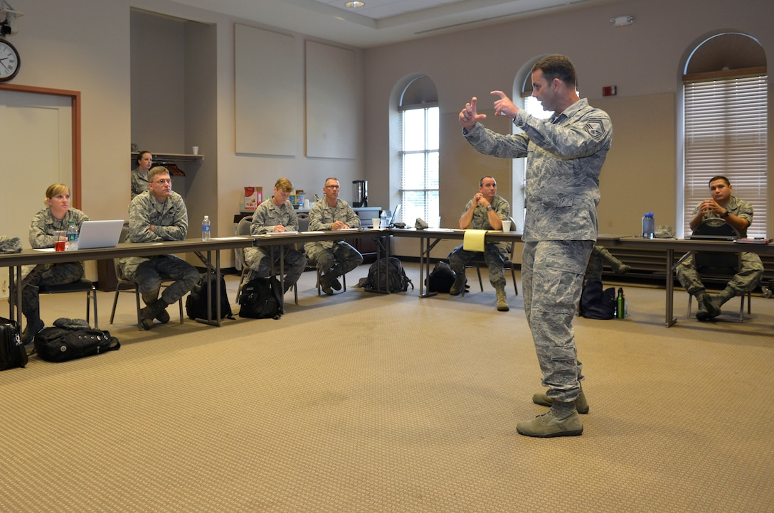 MCGHEE TYSON AIR NATIONAL GUARD BASE, Tenn. – Senior Master Sgt. Shaun Withers, career field manager for National Guard Bureau public affairs, speaks with Air National Guard public affairs students in the Public Affairs Managers Course at the I.G. Brown Training and Education Center here, July 16, 2013, about marketing official photography. (U.S. Air National Guard photo by Master Sgt. Kurt Skoglund/Released)