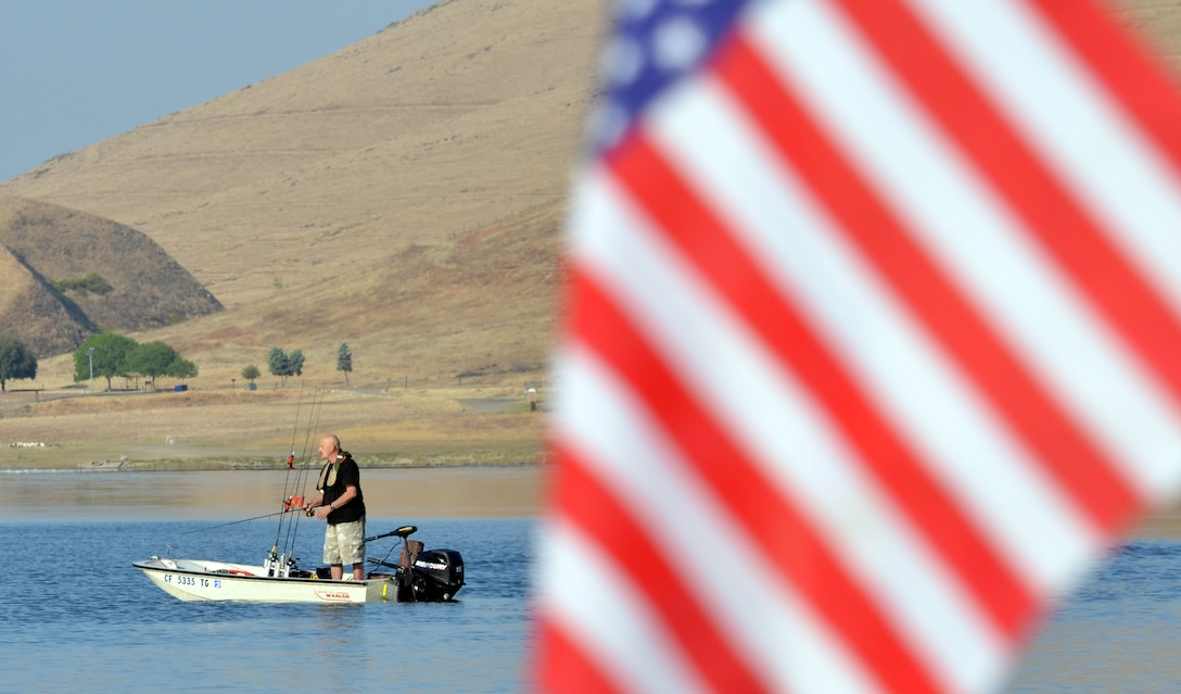 A bass fisherman casts a line at Success Lake, a U.S. Army Corps of Engineers project near Porterville, Calif.