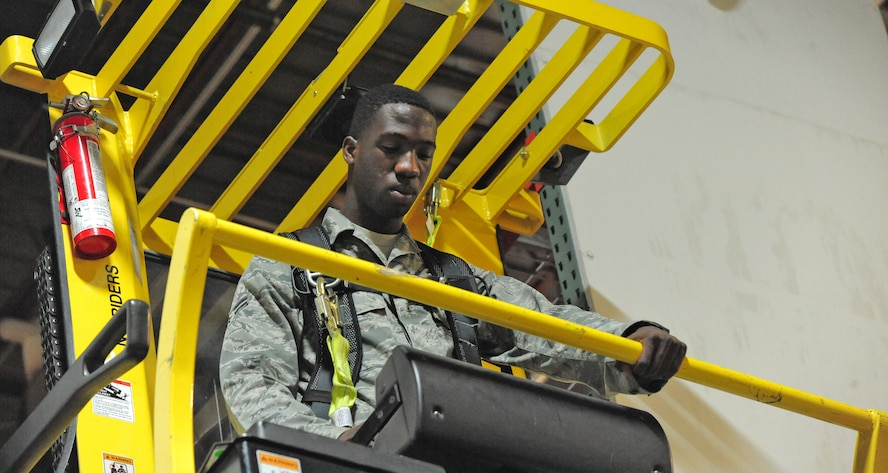 Airman 1st Class Terrell Grant, 509th Logistics Readiness Squadron central storage journeyman, uses a hyster to pull heavy equipment off of a shelf at the central storage warehouse at Whiteman Air Force Base, Mo., June 25, 2013. Hysters help Airmen lift equipment that weighs up to one ton. (U.S. Air Force photo by Staff Sgt. Nick Wilson/Released)