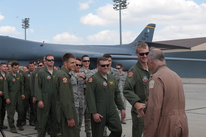 Airmen at Ellsworth Air Force Base, S.D., congratulate Lt. Col. Timothy Schepper, 28th Operations Group senior evaluator, on being the first person to achieve 5,000 hours flying B-1 bombers, July 15, 2013. Schepper reached the milestone during a 19 – hour mission that originated in Southwest Asia. (U.S. Air Force photo by Airman 1st Class Zachary Hada/Released)