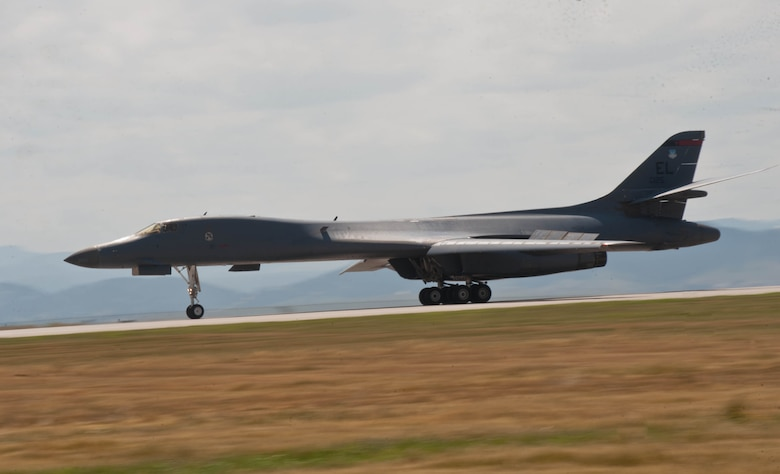 A B-1 bomber piloted by Lt. Col. Timothy Schepper, 28th Operations Group senior evaluator, thunders down the runway at Ellsworth Air Force Base, S.D., July 15, 2013. Schepper, who passed the 5,000 flying hours mark during a return flight from Southwest Asia, is the first B-1 aviator to reach the milestone in that aircraft. (U.S. Air Force photo by Airman 1st Class Zachary Hada/Released)