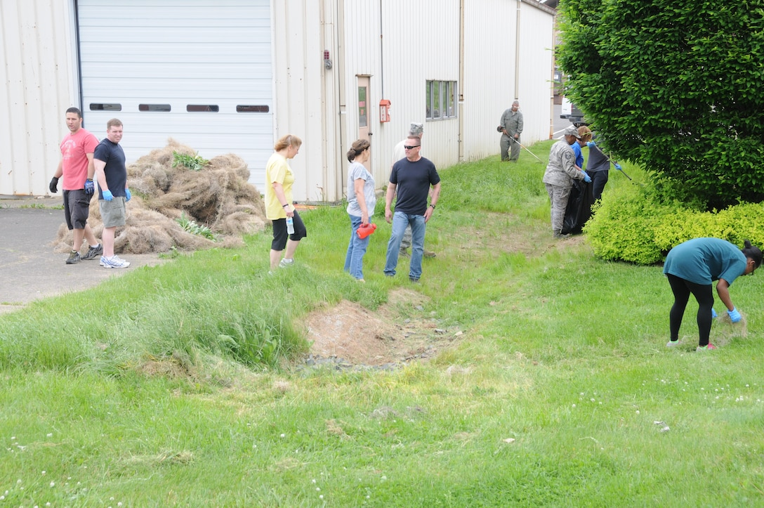 Wing personnel join in on an afternoon, base-wide cleanup project here on May 23. A broad spectrum of repair, beautification and equipment relocation projects were addressed immediately following the morning's 101 critical days of summer briefings from Lt. Col. Scott Hreso, the wing's chief of safety officer. Everyone really pitched in to make the day a true success again, said Hreso. We hope to hold this kind of self-help program two times a year he added.