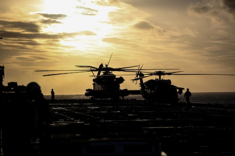 A CH-53E Super Stallion helicopter from Marine Medium Tiltrotor Squadron 265 (Reinforced), 31st Marine Expeditionary Unit, and a SH-60 Seahawk helicopter of Helicopter Sea Combat Squadron 25, await clearance to take off here, July 17. The 31st MEU and Amphibious Squadron 11 are part of the 18,000 U.S. personnel participating in the month long, bilateral training exercise alongside more than 9,000 Australian soldiers in the fifth iteration of Talisman Saber.