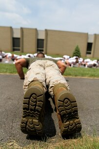 MORRISVILLE, NY, (June 24, 2013)— Sergeant Adam T. Leyendecker, the marketing and public affairs Marine at Recruiting Station Buffalo, NY, leads his group of boys in a set of push-ups during the annual New York American Legion Boy's State at the State University of New York, Morrisville, June 24, 2013.