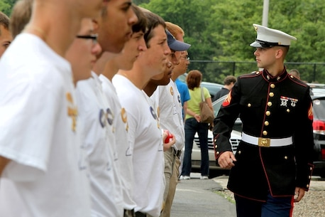 MORRISVILLE, NY, (June 28, 2013)—Cpl Richard Marko III, a recruiter at Recruiting Substation Utica, NY, reviews his formation of boys for proper cover and alignment at the annual New York American Legion Boy's State at the State University of New York, Morrisville, June 28, 2013. Marko, a native of Newport, NY and 2009 graduate of West Canada High School, is a 2008 Boy's State alum. After attending Boy's State, Marko decided to enlist in the Marine Corps Reserves, forgoing an ROTC scholarship for a stint in the Marines as an aircraft maintenance administration specialist. Boy's State is a week-long civics and government camp for incoming high school seniors sponsored by the American Legion designed to give participants a better understanding of American governance and introduce them to the Marine Corps.  Marines from RS Albany, RS New York, and RS Buffalo, volunteer their time to assist the American Legion during Boy's State each year. The Marines teach their boys basic drill and ceremony, physical fitness, and Marine Corps ethics. (Official Marine Corps Photo by Sgt Timothy T. Parish)(RELEASED)