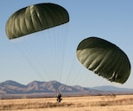 Soldiers from the 1st Platoon, 84th Engineer Support Company, 6th Engineer Battalion (Combat) (Airborne), conduct parachute landings during a training exercise at Fort Huachuca, Ariz., prior to beginning the construction of an access road for the Border Patrol.