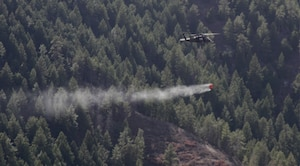 A UH-60 Black Hawk helicopter from the Colorado Army National Guard's 2nd Battalion, 135th General Support Aviation, drops 500 gallons of water from a specialized bucket onto the Lower North Fork Fire in the vicinity of Conifer Colo., March 28, 2012. Army National Guard Sgt. Ryan Osadchuk, a UH-60 Black Hawk helicopter crew chief with the Colorado Army National Guard's 2nd Battalion, 135th General Support Aviation Battalion, Company A, prepares his helicopter for flight at Buckley Air Force Base in Aurora, Colo., March 28, 2012. The 2-135th GSAB is operating under the governor's executive order to assist the Colorado Division of Emergency Management, the Colorado State Forest Service, and the Jefferson County Sheriff's Office in fighting the fire, which began March 26 in Jefferson County, Colo. The fire has given rise to the evacuation of more than 900 homes and is estimated to have covered more than 4,000 acres.