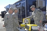 Members of NORAD and USNORTHCOM take a look at the latest innovations in Chemical, Biological, Radiological and Nuclear response equipment at the NORAD and USNORTHCOM CBRN Summit March 13, 2012. The purpose of this year's summit is to bring together Canadian and U.S. CBRN personnel from local, state, national and military organizations to give the current composition of the CBRN Response Enterprise a hard look and determine if changes need to be made.