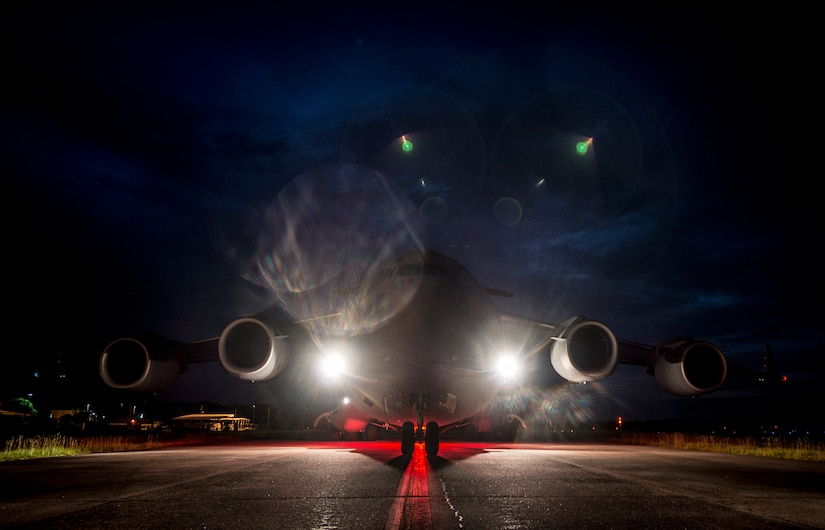 """A C-17 Globemaster III taxis to the runway before taking off to perform """"touch and goes"""" July 17, 2013, at Joint Base Charleston – Air Base, S.C. Airmen from the 437th Airlift Wing work around the clock on the flightline to provide combat-ready C-17A aircrews, mission support personnel and processes for 53 assigned aircraft to meet White House, Department of State and Joint Chiefs of Staff-directed global deployment, employment and resupply of Department of Defense and allied forces via air-land and airdrop operations. (U.S. Air Force photo/ Senior Airman Dennis Sloan)"""