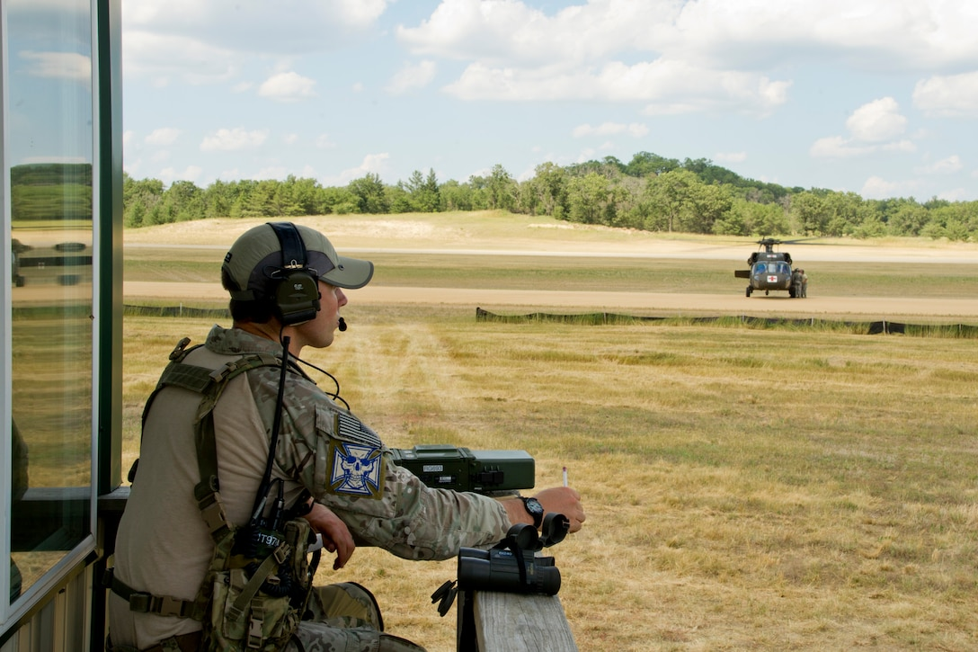 Staff Sgt. Spencer Zephan provides air traffic control on a soft field during Exercise Global Medic July 16, 2013, at Fort McCoy, Wis. Global Medic is an annual joint-Reserve field-training exercise designed to replicate all facets of combat theater aeromedical evacuation support. Zephan is a combat controller assigned to the 125th Special Tactics Squadron at Portland Air National Guard Base, Ore. (U.S. Air Force photo/Staff Sgt. Heather Cozad)