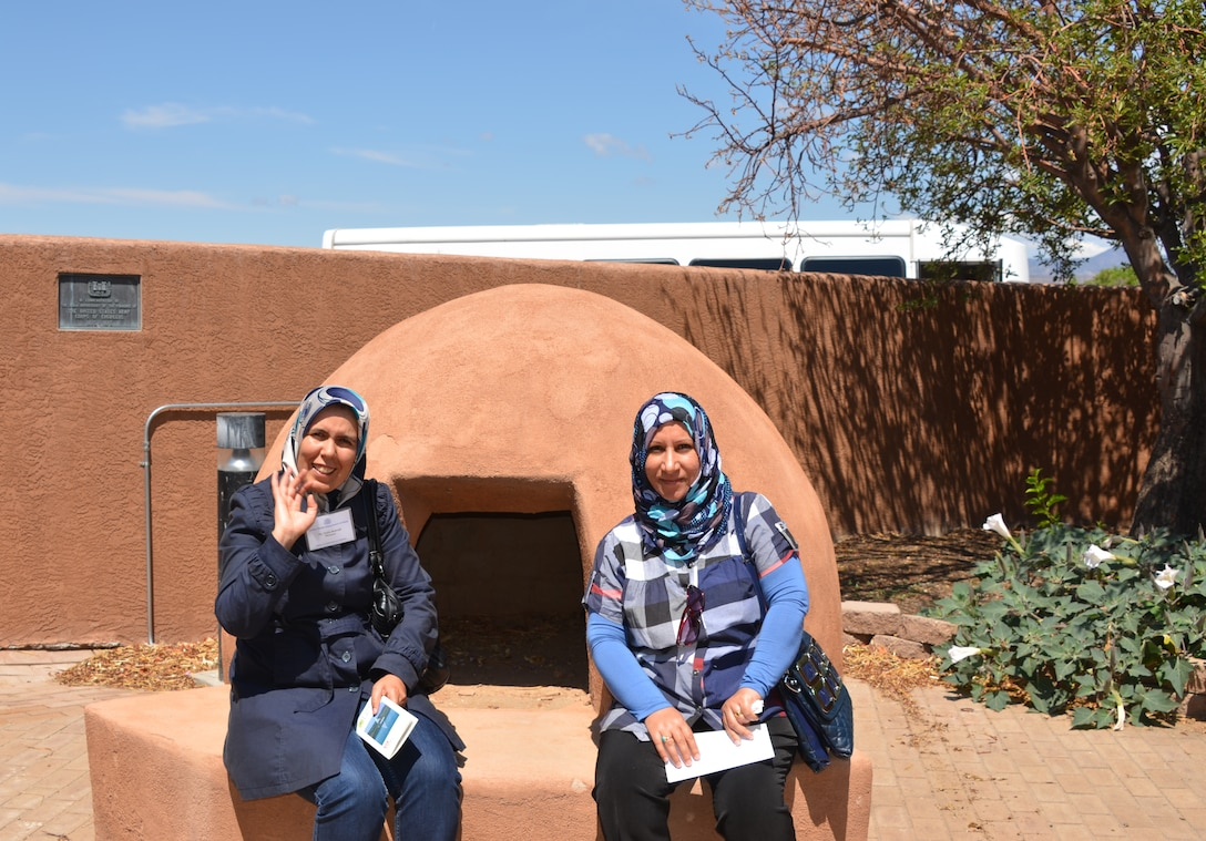 COCHITI LAKE, N.M., -- Two of the visiting water managers stop to appreciate the kiva in front of the Cochiti Lake project office, July 3, 2013.