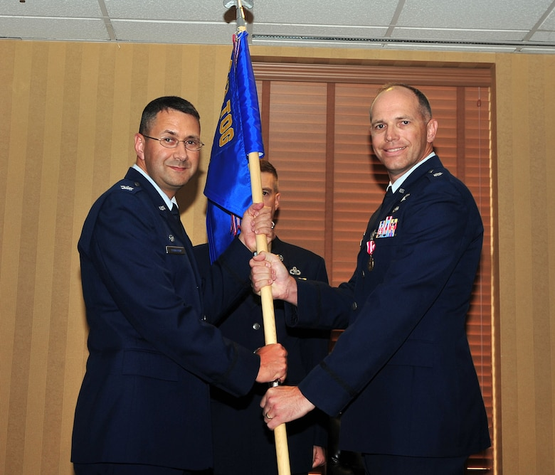 Col. Jonathan VanNoord, 612th Theater Operations Group commander, takes the 612th Support Squadron guidon from Lt. Col. Ryan Hollman, out-going 612th Support Squadron commander, during a change-of-command ceremony on Davis-Monthan AFB, Ariz., July 16. (USAF photo by 355th Fighter Wing Public Affairs/Released)