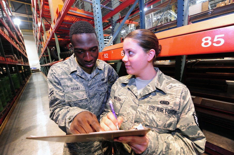 Airman 1st Class Terrell Grant and Senior Airman Stephanie Shipwash, both 509th Logistics Readiness Squadron central storage journeymen, perform warehouse location checks during an inventory check at the central storage warehouse at Whiteman Air Force Base, Mo., June 25, 2013. Inventory checks help Airmen ensure customers receive the correct parts. (U.S. Air Force photo by Staff Sgt. Nick Wilson/Released)