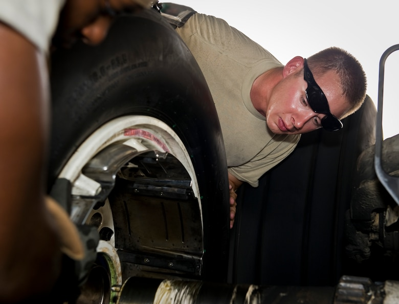 Staff Sgt. Daniel Sanney assists Senior Airman Denzale Render as they install a tire on a B-1B Lancer at the 379th Air Expeditionary Wing in Southwest Asia, July 15, 2013. Sanney is a 379th Expeditionary Maintenance Group B-1 quality assurance inspector, and Render is a 34th Aircraft Maintenance Unit B-1 crew chief. Both are deployed from Ellsworth Air Force Base, S.D. (U.S. Air Force photo/Senior Airman Benjamin Stratton)