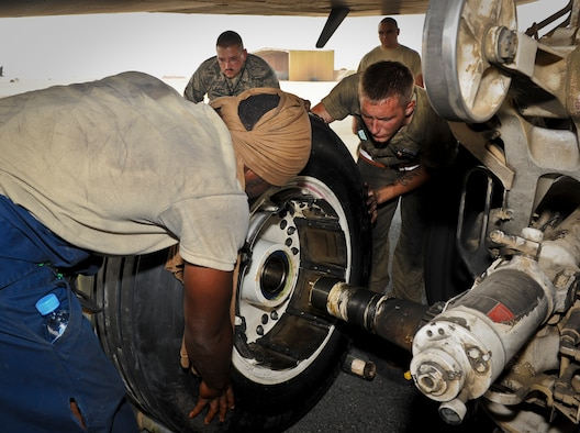 B-1B Lancer crew chiefs from the 34th Aircraft Maintenance Unit work to fix a blown tire as Tech. Sgt. Jeffrey Bailey ensures the work is completed following safety guidelines contained within their technical orders at the 379th Air Expeditionary Wing in Southwest Asia, July 15, 2013. Bailey is a 379th Expeditionary Maintenance Group quality assurance inspector deployed from Mountain Home Air Force Base, Idaho, and these crew chiefs are deployed from Ellsworth Air Force Base, S.D. (U.S. Air Force photo/Senior Airman Benjamin Stratton)
