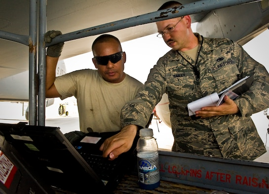 Tech. Sgt. Jeffrey Bailey ensures Staff Sgt. David Garcia is entering task data on his technical order correctly at the 379th Air Expeditionary Wing in Southwest Asia, July 15, 2013. Bailey is a 379th Expeditionary Maintenance Group quality assurance inspector deployed from Mountain Home Air Force Base, Idaho, and Garcia is a 379th Expeditionary Maintenance Squadron repair and reclamation specialist deployed from McConnell Air Force Base, Kan. (U.S. Air Force photo/Senior Airman Benjamin Stratton)