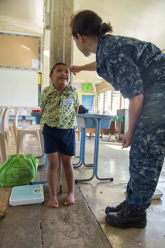 Navy Seaman Rebekah Abernathy measures the height of a child being screened during a Pacific Partnership 2013 health fair in Apia, Samoa, to compete in Samoan Special Olympics activities, June 8, 2013. Pacific Partnership is the largest disaster response-preparation mission in the Indo-Asia-Pacific region. U.S. Navy photo by Petty Officer 3rd Class Samantha J. Webb