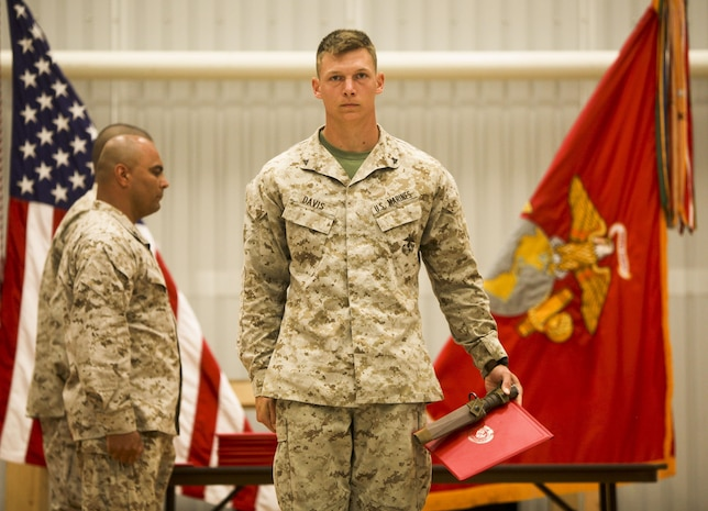 Lance Cpl. Andy Davis, a rifleman with Black Sea Rotational Force 13 and Richmond Hill, Ga., native, marches off the stage after receiving  a certificate and bayonet for being the honor graduate of Corporals Course class 44-13, June 23, 2013 out of Mihail Kogalniceanu Military Base, Romania.  Marines with BSRF-13 who attended Corporals Course learned the basics of being a non-commissioned officer in the United States Marine Corps. Corporals Course is a formal school that is a requirement for all corporals that want to be eligible for the rank of sergeant.