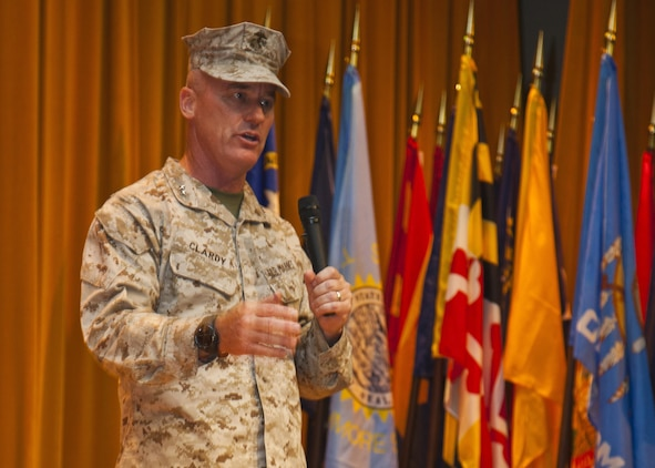 """Maj. Gen. H. Stacy Clardy III speaks to Japanese officials and U.S. Marines and sailors during the 3rd Marine Division change of command ceremony July 12 at the Camp Courtney theater. """"I am so honored and humble to have this opportunity. To get the chance to come here, to this inspiring division, and take over for a good friend of mine is quite an honor for me,"""" said Clardy. """"I very much look forward to serving with the finest division in the Marine Corps, and I look forward to the challenges ahead."""" Clardy's previous assignment was at Headquarters, U.S. Marine Corps where he served as the Director of Operations with Plans, Policies and Operations. Padilla's next command will be at Headquarters, U.S. Marine Corps where he will serve as the Director of Operations with Plans, Policies and Operations. The division is part of III Marine Expeditionary Force. (U.S. Marine Corps photo by Lance Cpl. Brandon C. Suhr/Released)"""