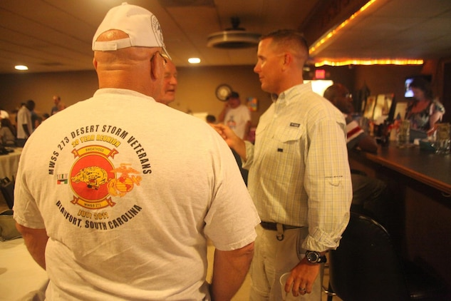 Veterans of Marine Wing Support Squadron 273, converse with Maj. Charles Sprietsma, the executive officer of MWSS-273, during a reunion at the Beaufort Veterans of Foreign Wars, July 12. The veterans journeyed across states in order to see the future of the squadron they once proudly served.