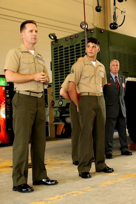 Cpl. Lucas Matte (center), a motor transport technician with Marine Wing Support Squadron 273, stands aside Col. William Lieblein (left), the commanding officer of Marine Aircraft Group 31, during an awards ceremony, July 12, recognizing Matte for his superior performance throughout 2012. Matte was recognized by the Marine Corps Motor Transport as the Motor Transport Technician of the Year for 2012, an award earned by Matte after being selected from a occupational field that contains almost 15,000 Marines.