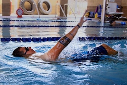 Sgt. Dominic Thiemann, a patient from Wounded Warrior Battalion West, swims during a wounded warrior swim camp here July 18.