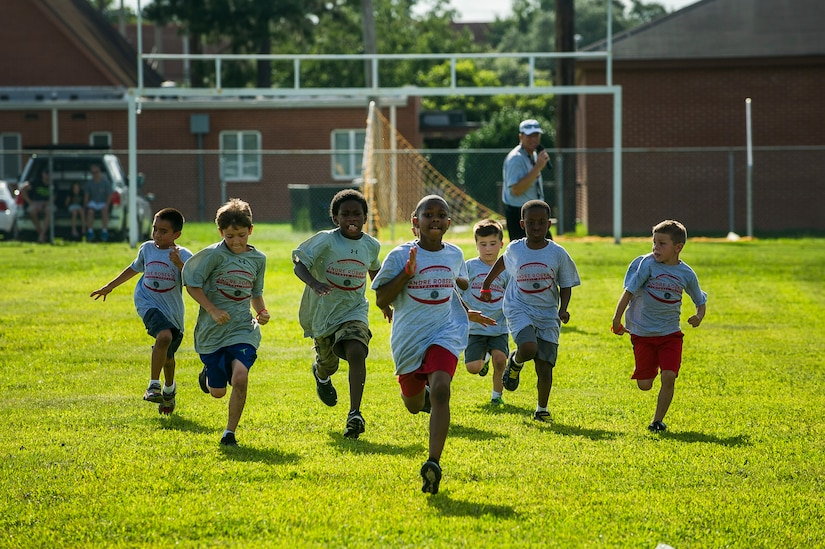 Children run a 40 yard dash during the Andre Roberts Pro Camp, July 15, 2013, at Joint Base Charleston - Weapons Station, S.C. More than 100 base children attended the Andre Roberts Pro Camp on July 15-16. The camp was paid for by Roberts, enabling the children to attend for free. (U.S. Air Force photo/ Senior Airman George Goslin)