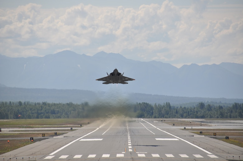 An F-22 Raptor takes off after being hot-pit refueled July 13, 2013, at Joint Base Elmendorf-Richardson, Alaska. The Raptors were flown by Reserve pilots assigned to the 302nd Fighter Squadron during the 477th Fighter Group's monthly training weekend. During the week, the 477th Fighter Group, Alaska's only Reserve unit, integrates with the active duty 3rd Wing. (U.S. Air Force/Tech. Sgt. Dana Rosso)