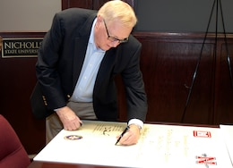 Nicholls State President Dr. Stephen Hulbert signs the Memorandum of Agreement with the U.S. Army Corps of Engineers, New Orleans District, July 17, 2013.