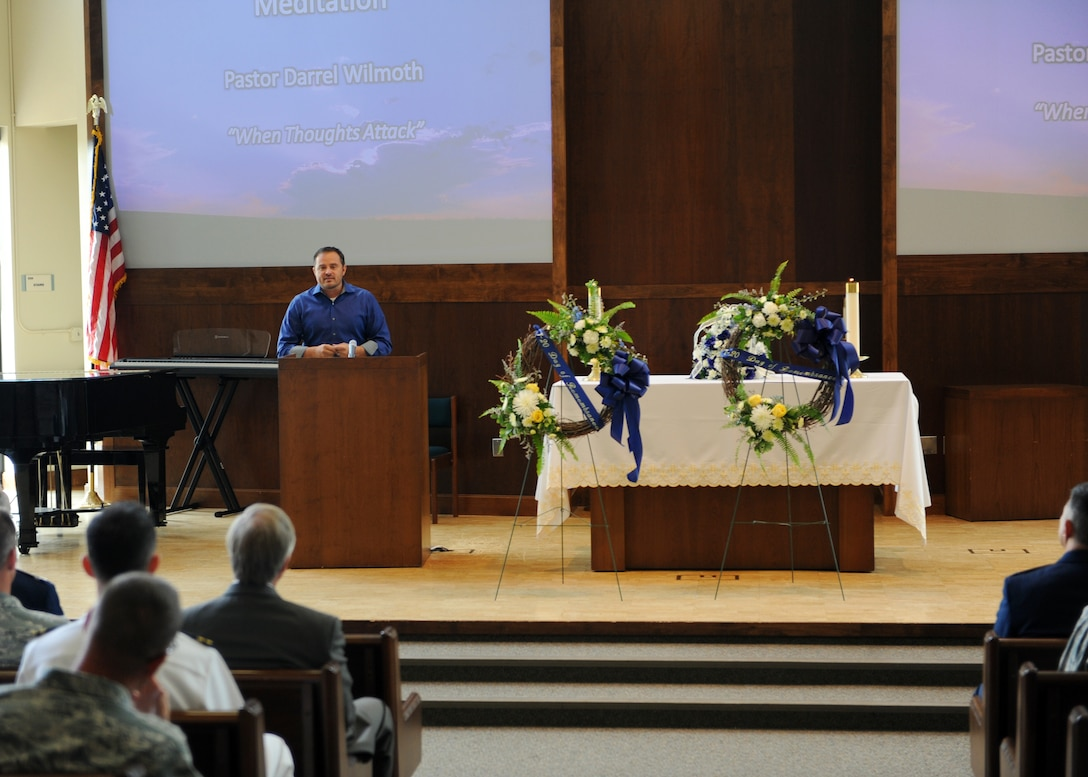 Pastor Darrel Wilmoth, Front Range Calvary, speaks about the Aurora Theater tragedy July 19, 2013, at Buckley Air Force Base, Colo. Wilmoth is a survivor of the incident and spoke about remembering the good no matter how burdensome the bad may be. He also honored the 12 victims who lost their lives and the countless number of people affected by the theater shooting. (U.S. Air Force photo by Senior Airman Marcy Glass/Released)