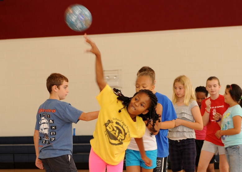 Azaria Edwards, daughter of Staff Sgt. Letitia Edwards, Air Force Reserve Command, throws a ball July 16, 2013, at the youth center on Buckley Air Force Base, Colo. The Sidelines Sports Camp gave children the opportunity to learn about a variety of unique sports. (U.S. Air Force photo by Senior Airman Marcy Glass/Released)
