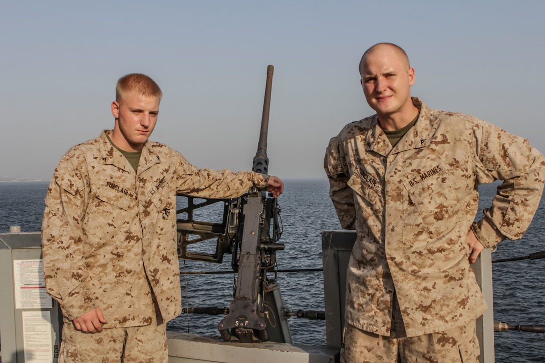 U.S. Marine Corps Lance Cpls. Matt Sinclair and Daniel Sinclair, brothers from Easton, Md., assigned to Combat Logistics Battalion 26, 26th Marine Expeditionary Unit (MEU), are currently both embarked aboard the USS Carter Hall (LSD 50) while at sea July 18, 2013. The 26th MEU is a Marine Air-Ground Task Force forward-deployed to the U.S. 5th Fleet area of responsibility aboard the Kearsarge Amphibious Ready Group serving as a sea-based, expeditionary crisis response force capable of conducting amphibious operations across the full range of military operations. (U.S. Marine Corps photo by Cpl. Michael S. Lockett/Released)