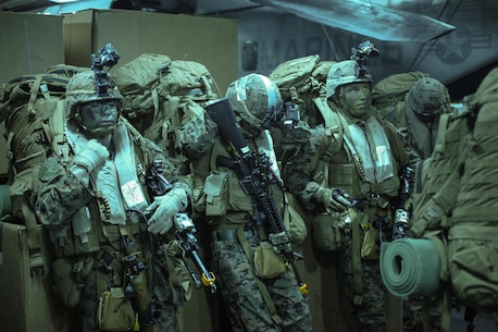 Marines with Company E., Battalion Landing Team 2nd Battalion, 4th Marines, 31st Marine Expeditionary Unit, wait to board aircraft for an aerial assault here, July 21. The Marines and Sailors of the 31st MEU and Amphibious Squadron 11 are part of an integrated force of approximately 18,000 U.S. service members training alongside approximately 9,000 Australian service members in the fifth iteration of Talisman Saber 2013, a month-long biennial exercise designed to enhance multilateral collaboration in support of future combined operations, natural disaster, humanitarian and emergency response. The 31st MEU is the Marine Corps' force in readiness for the Asia Pacific region and the only continuously forward-deployed MEU.