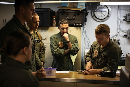 Captain Joshua E. Carpenter, an MV-22 Osprey pilot for Marine Medium Tiltrotor Squadron 265 (Reinforced), 31st Marine Expeditionary Unit, briefs his co-pilot and crew chiefs in preparation for an aerial assault here, July 21. The Marines and Sailors of the 31st MEU and Amphibious Squadron 11 are part of an integrated force of approximately 18,000 U.S. service members training alongside approximately 9,000 Australian service members in the fifth iteration of Talisman Saber 2013, a month-long biennial exercise designed to enhance multilateral collaboration in support of future combined operations, natural disaster, humanitarian and emergency response. The 31st MEU is the Marine Corps' force in readiness for the Asia Pacific region and the only continuously forward-deployed MEU.