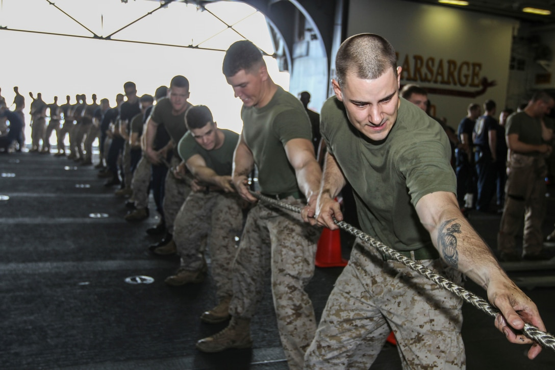 U.S. Marine Corps Sgt. William Repass, 26th Marine Expeditionary Unit (MEU) assistant headquarters commandant, pulls on a rope to secure lines between the USS Kearsarge (LHD 3) and the USNS Patuxent (T-AO-201), while underway, July 20, 2013. The 26th MEU is a Marine Air-Ground Task Force forward-deployed to the U.S. 5th Fleet area of responsibility aboard the Kearsarge Amphibious Ready Group serving as a sea-based, expeditionary crisis response force capable of conducting amphibious operations across the full range of military operations. (U.S. Marine Corps photo by Cpl. Kyle N. Runnels/Released)