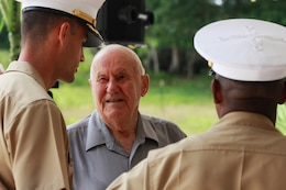 Major Christopher Merrill, a Wyoming native and Operations officer with Marine Corps Activity Guam, speaks with William Mays, a Marine who fought on Guam in 1944 during the liberation, at the Chagui'an Massacre memorial event July 16 in Yigo, Guam.  On this site, Japanese fighters massacred a group of Chamorro men after forcing them to move supplies across the island.  The ceremony was one of many held across the island to celebrate the liberation of the island from Japanese oppression and occupation in 1944.  (Official U.S. Marine Corps photo by Sgt. John Raufmann)