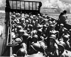 Marines prepare to storm the beaches on a landing craft just before the liberation of Guam July 21, 1944. Marine Corps Activity Guam Marines honored the sacrifice of those lost and celebrated with local residents in this year's 69th Liberation celebration, which concluded Sunday with the Liberation Day Parade.  Each year, July is dedicated to preparing for and celebrating the liberation of the island from Japanese occupation during World War II.  (Official U.S. Marine Corps photo by Sgt. John Raufmann)