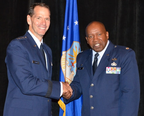 Director of the Air National Guard Lt. Gen. Stanley E. Clarke III (left) congratulates Roy Wilkins Renowned Service Award recipient Lt. Col. Anderson Neal Jr. during an Armed Services and Veterans Affairs Awards luncheon in Orlando, Fla., July 16, 2013. Photo by Master Sgt. Thomas Kielbasa