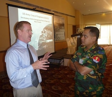 Sean Dowling, USACE-Pacific Ocean Division's regional civil disaster contingency planner, discusses debris reduction techniques with Lt. Col. Saiful Islam from the Bangladesh Army.  (Photo by Justin Pummell)