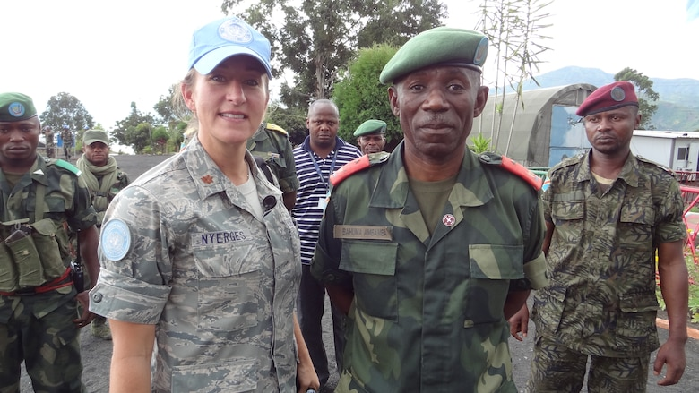 U.S. Air Force Maj. Jana Nyerges with  Democratic republic of the Congo Gen. Bahuma, Goma, Democratic Republic of the Congo, taken during her UN deployment as an intelligence analyst with peacekeepers. (U.S. Air Force Photo courtesy of Maj. Jana Nyerges/Released)