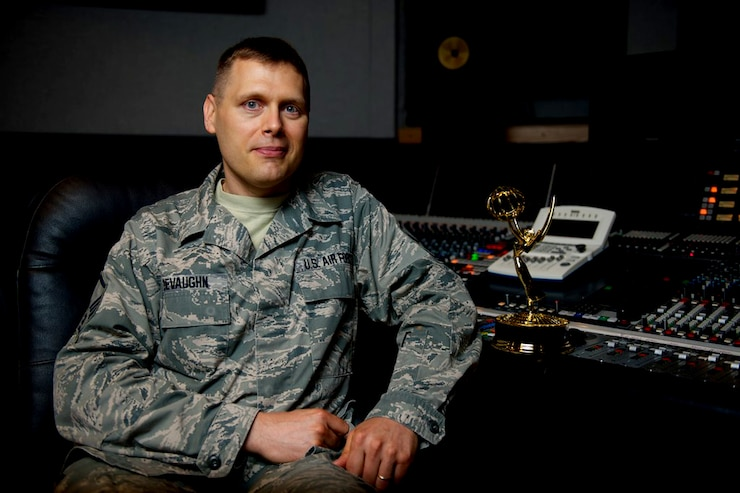 Master Sgt. James DeVaughn smiles for a photo beside his regional Emmy® trophy July 3, 2013, at Bolling Air Force Base, in Washington, D.C. DeVaughn is an audio engineer and production assistant for The U.S. Air Force Band and received the award for his contributions to the live audio of a Veteran's Day concert, broadcast on Nov. 11, 2012. (U.S. Air Force photo/Airman 1st Class Alexander W. Riedel)