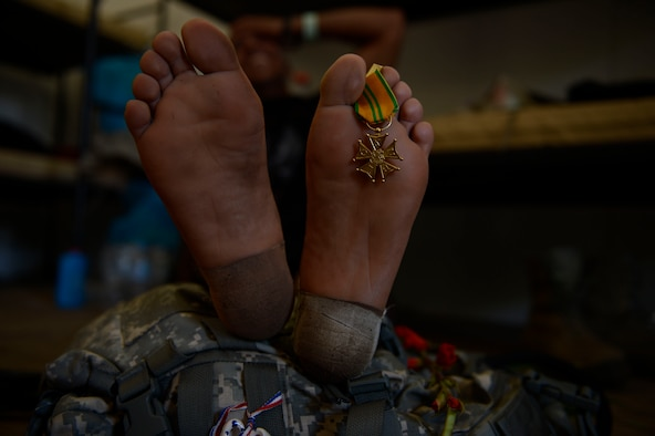 NIJMEGEN, Netherlands -- A Golden Cross medal rests on the foot of a 52nd Logistic Readiness Squadron team member during the International Four Days Marches July 19, 2013. The 52nd LRS team started with 11 members, and four members completed the 100-mile march. (U.S. Air Force photo by Senior Airman Natasha Stannard/Released)