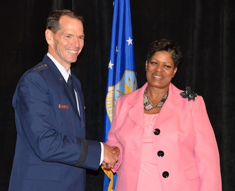 Director of the Air National Guard Lt. Gen. Stanley E. Clarke III (left) congratulates the Benjamin L. Hooks Distinguished Service Award recipient Phyllis Brantley during an Armed Services and Veterans Affairs Awards luncheon in Orlando, Fla., July 16, 2013. Photo by Master Sgt. Thomas Kielbasa