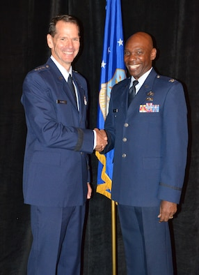 Director of the Air National Guard Lt. Gen. Stanley E. Clarke III (left) congratulates Recipient of the NAACP Meritorious Service Award, Col. Ondra Berry during an Armed Services and Veterans Affairs Awards luncheon in Orlando, Fla., July 16, 2013. Photo by Master Sgt. Thomas Kielbasa