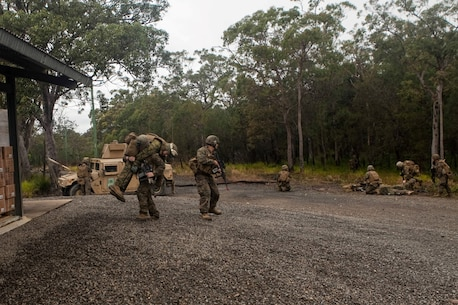 Marines and Sailors of Company E., Battalion Landing Team 2nd Battalion, 4th Marines, 31st Marine Expeditionary Unit, provide security while evacuating casualties after an ambush during Talisman Saber 2013, here, July 23. Australian Army soldiers of the 7th Brigade are serving as the opposing force during the biennial training exercise which is designed to foster and sustain cooperative international relationships that enhance regional security, stability and prosperity. The 31st MEU is the Marine Corps' force in readiness in the Asia-Pacific region and is the only continuously forward deployed MEU.