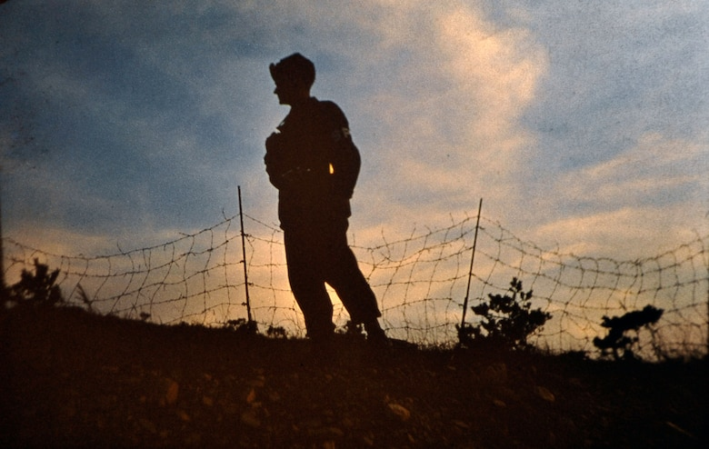 A guard patrols inside of a compound near the 38th parallel in South Korea. Retired U.S. Army Maj. E. Vernon Smith Jr. used photography as a way to preserve memories of his experience during his rotation there from 1956-58. (Courtesy photo/Released)