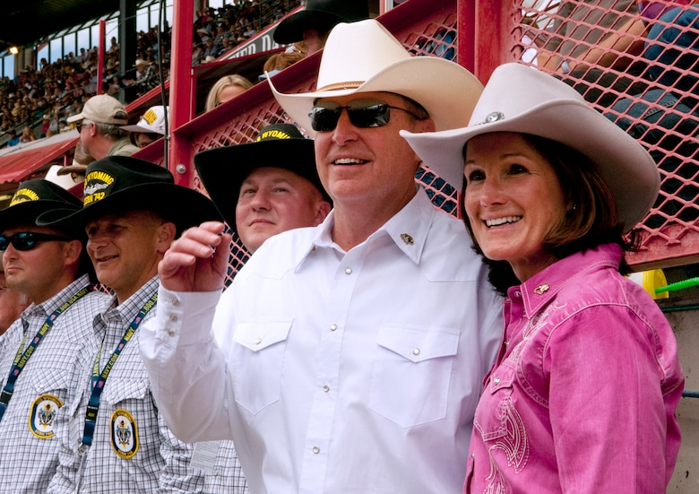 Air Force Chief of Staff Gen. Mark A. Welsh III and his wife, Betty, enjoy scenes from the 117th annual Cheyenne Frontier Days rodeo July 20, 2013, held in Frontier Park, Cheyenne, Wyo. Welsh, who served as grand marshal for the opening parade, visited the region to participate in CFD events, but also to thank Airmen and the community for the continued service and support. (U.S. Air Force photo by R.J. Oriez)