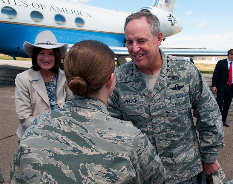 Col. Tracey Hayes, 90th Missile Wing commander, greets Air Force Chief of Staff Gen. Mark A. Welsh III and his wife, Betty, after they arrive at Cheyenne Regional Airport, Wyo., July 19, 2013. Welsh arrived to take part in Cheyenne Frontier Days and to thank Warren Airmen and community members for their continued service and support. (U.S. Air Force photo by R.J. Oriez)