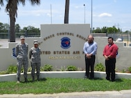 EGLIN AFB, Fla. -- A team of personnel from both Eglin Air Force Base and RAF Fylingdales was named the May Gold Knight award recipient. Pictured (left to right) are Senior Airman Kaleb Gage, 2nd Lt. Celeste Crenshaw, Kevin McKinion and Mark Starnes from Eglin AFB. The team introduced an operator and analyst exchange program to share technical discussions and procedures. (U.S. Air Force photo)